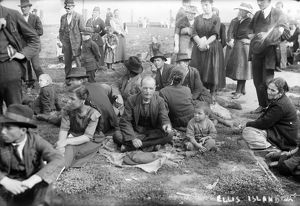 ELLIS ISLAND, C1910. New immigrants sitting on the lawn at Ellis Island. Photograph