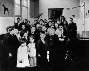 ELLIS ISLAND, c1915. A group of immigrant children learning American songs in a