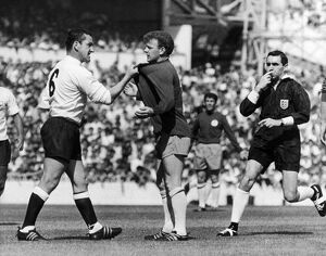 ENGLAND: SOCCER MATCH, 1966. Dave McKay (left) of Tottenham Hotspur confronts Billy
