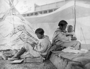 ESKIMO FAMILY, c1901. An Eskimo man, woman and baby in the Eskimo village exhibit
