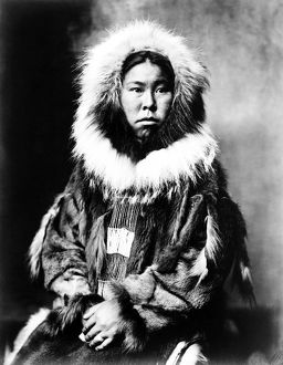 ESKIMO WOMAN, c1903. Inuit woman seated and wearing traditional fur clothing. Photograph