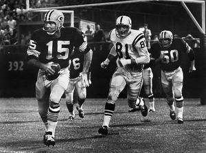 FOOTBALL GAME, 1966. Quarterback Bart Starr of the Green Bay Packers attempting to