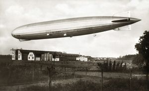 GRAF ZEPPELIN IN FLIGHT. Photograph, 20th century.