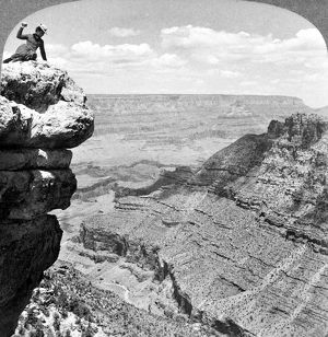 GRAND CANYON, c1903. A woman seated on a cliff overlooking the Grand Canyon in Arizona