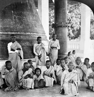 A group of Buddhist monks in front of the Great Bell of Mingoon at the temple, Mingoon, Burma