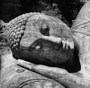 Head of the 12th century giant reclining Buddha figure carved out of granite rock at Gal Vihara