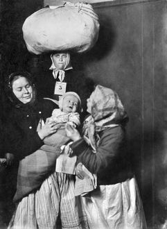 HINE: ELLIS ISLAND, 1905. A group of Italian immigrant women with a baby at Ellis Island