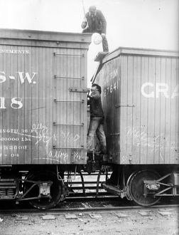 HOBOS, c1915. Hoboes fighting between railroad cars. Photograph, c1915