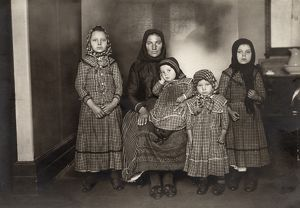 IMMIGRANT FAMILY, c1900. An immigrant woman and her four children. Photograph by Lewis W