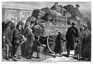 IMMIGRANT WAGON, 1873. A wagon carrying luggage of immigrants on the way to the