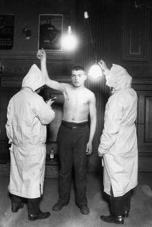 IMMIGRATION: EXAM, 1921. Members of the New York City Health Department examining