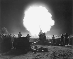 KOREAN WAR, 1952. A U.S. Army gun crew blasts off a howitzer at the enemy line somewhere