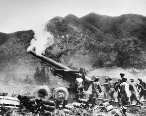 KOREAN WAR: ARTILLERY. U.S. artillerymen firing an 8-inch howitzer on the front in Korea