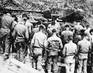 KOREAN WAR: CHURCH SERVICE. A U.S. Navy chaplain holds service for tank crewmen at