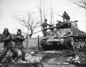KOREAN WAR: TANK, 1951. The crew of an Allied tank uses a lull in fighting near the