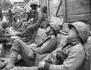 KOREAN WAR: U.N. TROOPS. Exhausted United Nations troops take a rest during a lull
