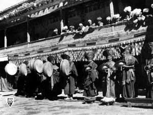 Lamas performing on traditional instruments as a prelude to a ceremony. Film still
