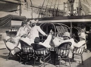 LIFE ON NAVAL SHIP, c1885. Officers relaxing with their feet up on the deck of