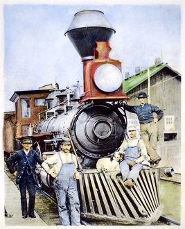 LOCOMOTIVE, 1883. The conductor, crew and canine mascot of a Central Pacific Railroad
