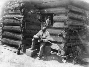 architecture/log cabin c1895 african american man seated