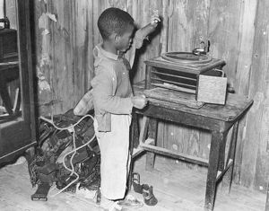 LOUISIANA: CHILD, 1939. African American child at a phonograph in Transylvania Project