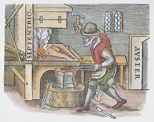 MAGNETIZING IRON, 1600. A blacksmith hammering a heated iron bar to be magnetized