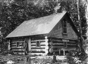 architecture/maine log cabin man standing log cabin lucky