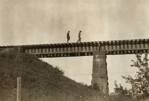 MASSACHUSETTS: TRESTLE. Boys walking across a trestle after work in Westfield