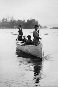 MICHIGAN: CANOE, c1903. Two Native American guides standing with two seated women