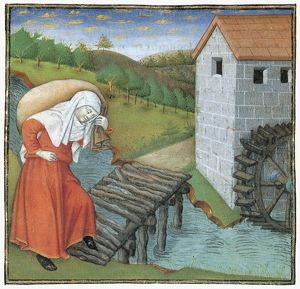 MILL, 15th CENTURY. A woman carrying a sack of wheat to a mill