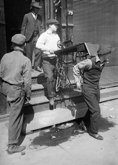 NEW YORK: HOBOS, 1915. Hobos moving Hotel de Gink, a hotel for itinerant workers