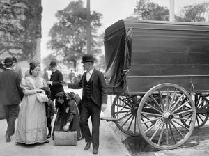 NEW YORK: IMMIGRANTS, c1900. Immigrants at Battery Park in New York City. Photograph