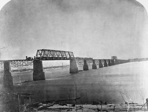 OHIO RIVER BRIDGE, 1870. The first passenger train passing over the Great Ohio River