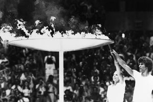 OLYMPIC GAMES, 1976. Torch bearers Sandra Henderson (age 16) and Stephane Prefontaine