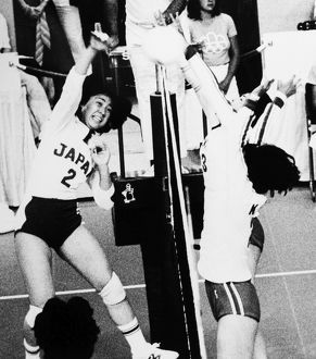 OLYMPICS: VOLLEYBALL, 1976. Mariko Okamoto of Japan spikes the ball past Kyungja Byon