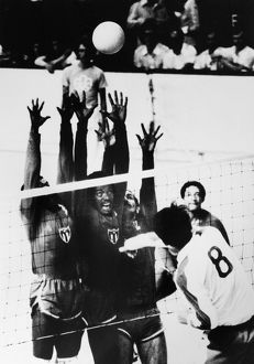 OLYMPICS: VOLLEYBALL, 1976. Mikiyasu Tanaka of Japan tries to spike the ball past