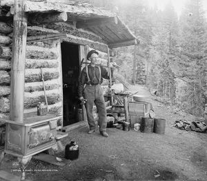 PIKE'S PEAK: PROSPECTOR. A prospector stands outside his cabin on Pike's Peak