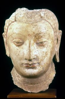 Polychrome stucco head of Buddha from Chinese Turkestan.