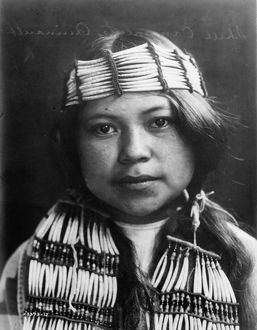 QUINAULT GIRL, c1913. Portrait of a Quinault girl from the Pacific Northwest by Edward S