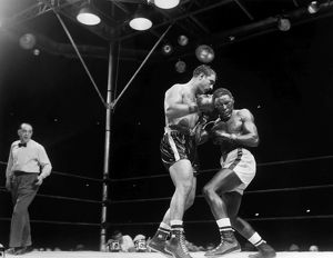 Rocky Marciano (left) defending his heavyweight title in a fight against Ezzard Charles