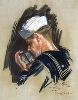 SAILOR, 1918. Portrait of a sailor looking at a picture of his sweetheart