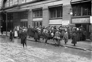 SALVATION ARMY, 1908. Crowd waiting at basket distribution window for Christmas dinner
