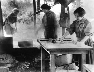 SALVATION ARMY, 1918. Women workers of the Salvation Army War Service making doughnuts