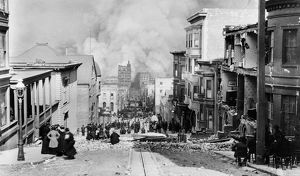 SAN FRANCISCO EARTHQUAKE. Crowd gathered on the street watching the city burn