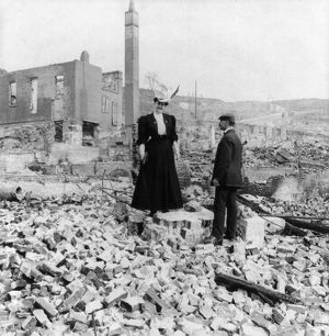 SAN FRANCISCO EARTHQUAKE. A man and woman standing amid the rubble, following the