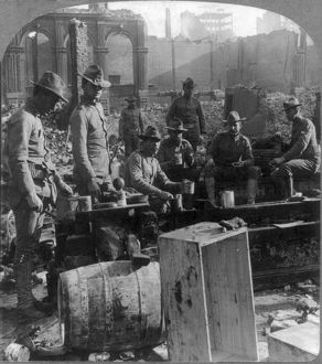 SAN FRANCISCO EARTHQUAKE. Soldiers having a meal in the burned district, following