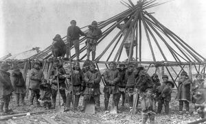 SIBERIA: ESKIMOS, c1897. A group of Eskimo men building a house in East Cape, Siberia