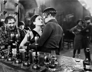 SILENT FILM: PARIS, 1926. Joan Crawford and Douglas Gilmore at the bar of an 'Apache