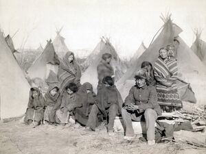 SIOUX ENCAMPMENT, 1891. Group of Minionjou Sioux Native Americans in a tipi camp