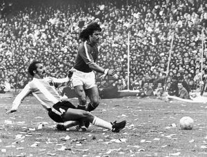 SOCCER MATCH, 1977. Kevin Keegan of England is tackled by an Argeninian defender